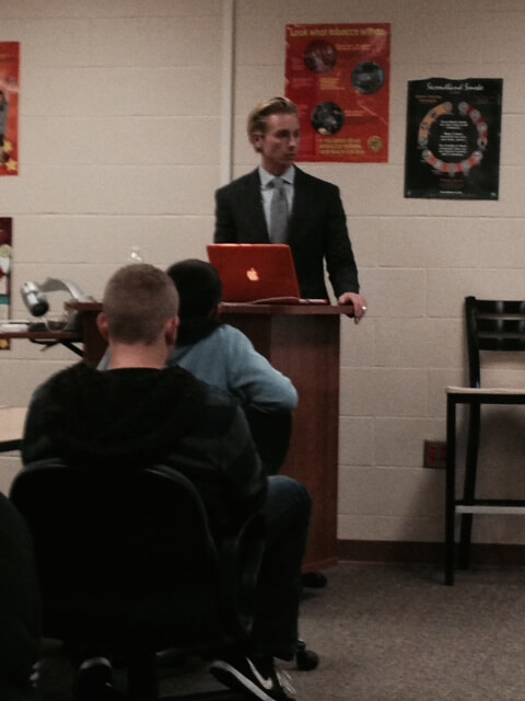 Attorney Brandon Hewitt speaks on distracted driving at the Byron Center in Grand Rapids