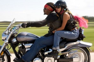couple on motorcycle without helmets